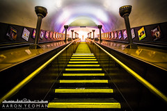 Transcendental (Aaron Yeoman) Tags: lighting city uk greatbritain travel england urban orange london lines station yellow architecture stairs underground subway lights vanishingpoint europe arch purple metro unitedkingdom empty curves escalator perspective halo railway tunnel arches symmetry line staircase gb symmetrical tubestation artdeco londonunderground escalators subwaystation curve vignetting vignette thetube metrostation piccadillyline adverts a77 tfl lul theunderground undergroundstation rapidtransit uplighter uplighters metropolitanrailway sigma1020mm1456exdchsm sonya77 southgatetubestation southgateundergroundstation slta77 sonyalphaslta77