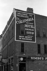 columbia hotel (bergytone) Tags: analog film bw olympus om2 om2n om series zuiko 50mm kentmere 100 xtol kalamazoo michigan columbia hotel advertisement bimbos pizza