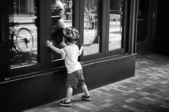 Reflecting (Rich McPeek) Tags: candid life pennsylvania socialdocumentaryphotography streetphotography streetportrait pittsburgh street kids helmet refflection sidewalk monochrome bnw