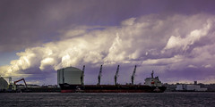 Storm Docking (myaarhkoo1) Tags: docking landscape hailstorm nature water port waterfont shippng newengland cargo urban maritime indusry crane coastal rhodeisland boat dramatic spring pier color tugboats clouds storm sky commerce usa ship providenceriver pvd dark shipping scenic river providence industrial eastcoast dock provport