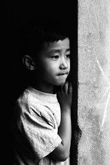 Peek-A-Boo (Gary Ellis Photography) Tags: dhulikhel nepal adorable afternoon bw beautiful beauty blackandwhite boy candidshot cheerfulness child colorful colourimage colourful curiosity cute daytime decay details digital environmental exterior gorgeous happiness happy joy kid lovable male monsoon oneperson outdoors outside playing portrait portraitphotography portraiture profile recreation shallowdepth sideon sideview sit sitting streetphotography sweet young