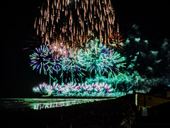 Lighting Up the Sky (Steve Taylor (Photography)) Tags: fun newzealand nz southisland canterbury christchurch newbrighton beach ocean pacific pier sea waves perspective silhouette reflection sky 5 5th 2015 bonfire crowd display firework november smoky watching