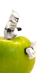 a apple a day... (photography.andreas) Tags: macro apple fruit canon germany deutschland photography starwars lego whitebackground series minifig minifigs saarland minifigure greenenergy minifigures canonef28135mmf3556isusm eos40d canoneos40d urweiler