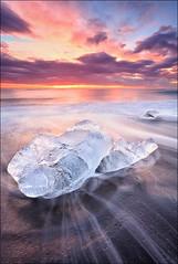 [ ... a journey`s end ] (D-P Photography) Tags: iceland breiðamerkursandur 051112ajourney´send afterhundredofyearsembeddedinthebreiðamerkurjökullglacier theicebergsfromglacierlagoonjökulsárlónwerereleasedtotheatlanticoceanandreturntotheblackbeachofbreiðamerkursandurkameracameracanoneos5dmarkiiiobjektivlenscanonef1740mm4lusmfilterhitech09ndreverse