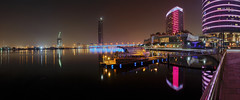 Dubai Festival City Night Panorama (Charn High ISO Low IQ) Tags: longexposure nightphotography panorama canon eos boat dubai uae citylights dubaicreek watertaxi waterreflection intercontinentalhotel 600d boatstation dubaifestivalcity