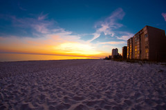 Gulf Shores Sunset 4 (Bradley Nash Burgess) Tags: sunset red sky orange cloud color building beach water clouds evening bay coast al sand nikon skies gulf dusk alabama fisheye condo condos shores 8mm gulfshores gulfshoresal d80 nikond80 rokinon rokinon8mm rokinon8mmfisheye