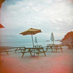 cornwall beach (nick richards art) Tags: sea 120 beach clouds coast holga lomo 120film parasol tables