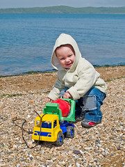 happy boy playing in the spring park on sea beach with toy (Maxim Tupikov) Tags: life park family boy vacation holiday playing cute male green fall beach parenthood nature water beautiful field grass car childhood smiling sport children fun toy happy person coast countryside kid spring healthy movement toddler warm little outdoor walk young meadow son wear kind parent enjoy friendly recreation enjoyment active
