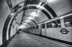 Aldwych Tube Station (vulture labs) Tags: city uk travel light england urban bw white black building london art abandoned station architecture train silver underground subway photography photo nikon industrial interior secret ghost tube tunnel aldwych software disused nik londonunderground nikkor derelict hdr lightroom photomatix efex d700 aldwychtubestation 1424mm silverfx vulturelabs