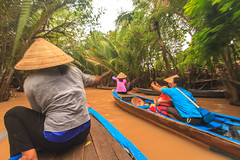 Let's take our picture! (julesnene) Tags: travel water boats boat asia southeastasia paddle palm vietnam waters mekongdelta mekong picturetaking asianwoman mekongriver strongwoman nónlá canoneos7d julesnene juliasumangil vietnameseboatwoman
