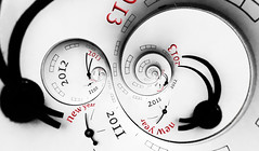 New year concept (liseykina) Tags: life new red 2 holiday abstract clock closeup modern circle spiral design long pointer time many snake background infinity year surreal twin dial double pole number celebration selected future timeline multiple imagination recursive arrow passing annual concept moment elegant now past infinite appointment impossible escheresque droste lifetime 2013 twince reverce