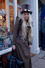 7D0086 Lady Adventurer with Big Top Hat & Goggles wearing brown stripped dress & brown leather basque - Whitby Goth Weekend 3rd Nov 2012 (gemini2546) Tags: nov leather top goth blonde week 3rd long wgw pinstriped 2470 brown canon sigma dress hair bag large carpet 7d lens basque hat whitby 2012 lady leather goggles adventurer binoculars