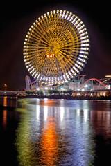A Wheel of Fortune (Belteshazzar (AKA Harimau Kayu)) Tags: longexposure light reflection japan night cityscape nightscape ferriswheel amusementpark rollercoaster yokohama urbanscape reflectiononwater cosmoclock
