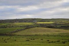 Green rolling hills of Lahinch Village in County Clare, Ireland (RYANISLAND) Tags: county ireland irish beach town europe clare european village beaches lahinch countyclare beachtown irishvillage lehinch liscannorbay liscannorbaybeach