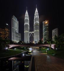 Twins in the middle (vedd) Tags: longexposure bridge architecture cityscape malaysia kualalumpur hdr petronastwintowers menaramaxis vertorama vedd canoneos60d