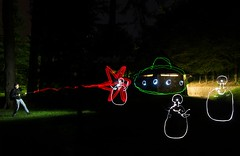 Alien invasion (Jumpin'Jack) Tags: lone brave trooper intercepting blob alien beings disembarking outof flying saucer spaceship ray gun blaster rifle explosion blast zap man soldier space blobs light painting long exposure night shot city park trees forest fun
