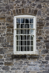 Grey Brown Stone Wall Metal Window Castle Detail (HunterBliss) Tags: arch architecture black bricks brown building castle close dark defense detail europe european exterior grey grid historic house inside ireland keystone landmark locked looking mansion metal monument old outside protection rocks rusted rustic stone stones strong texture thick tourism tourist town wall white window