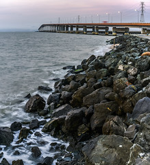 the weekend just washed up (pbo31) Tags: california bayarea nikon d810 color august 2016 summer boury pbo31 northerncalifornia fostercity sanmateocounty bridge sunset sanmateobridge shore bay rocks tide hide panoramic large stitched panorama infinity motionblur