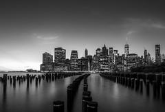 Gotham (mfoxb) Tags: newyork bw wasser hudson river mood stimmung monochrome sw manhattan explore outdoor fluss gotham skyline pier holiday light lights olympus architektur stadt einfarbig