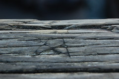 Wooden Star (laurelpattee) Tags: star wood wooden dock railing rail carved carving cracks abstract