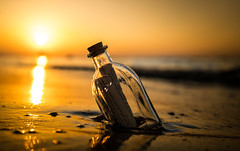 Beach Goods (--Conrad-N--) Tags: bottle post baltic sea flaschenpost korken brief letter sunset waves warnemnde