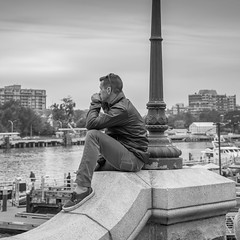 Contemplating the View (jsnmckenzie) Tags: victoria vancouverisland victoriabc britishcolumbia black white bc bw people sitting outdoor street streetphotography