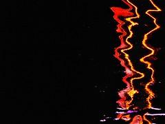 fire belt - Reflexion im Main, Michaelismesse in Miltenberg 2016 (zikade) Tags: reflexionen licht farbigeslicht farben gelb orange feuer main miltenberg odenwald kirmes volksfest michaelismesse 2016