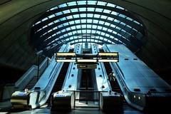 Sub-Calyx (Douguerreotype) Tags: futuristic underground docklands canarywharf city uk metro escalator british england tunnel stairs architecture britain gb subway london urban light tube steps