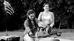 Girls on old tractor (patrick_milan) Tags: plouguin street rue people personne gens streetview fminin femal femme woman women girl fille belle beautiful portrait face candide noiretblanc blackandwhite noir blanc monochrome nb bw black white