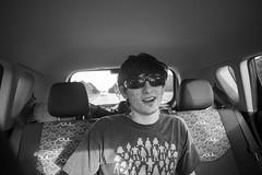 Josh (victorrollins) Tags: blackandwhite white man black car sunglasses shirt digital canon back sitting florida seat josh soul 5d passenger kia talking i75 markii