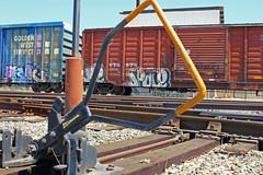 SPACE (KNOWLEDGE IS KING_) Tags: railroad art yard train bench graffiti paint wheels tracks railway rails railfan freight benched