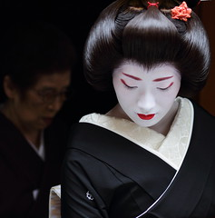 The geiko (geisha) Kofuku /   / Kyoto, Japan (momoyama) Tags: street new travel winter red portrait people woman house black flower colour history girl beautiful beauty face japan canon hair outdoors photography japanese photo costume kyoto asia day traditional culture makeup 85mm maiko geiko geisha 7d   historical kimono
