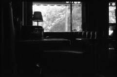 Booth by the Window (b.keelerfoster) Tags: california blackandwhite bw art film window lamp birds 35mm booth table photography la photo blackwhite losangeles empty diner hollywood nikonfm10 losfeliz 50mmlens nikonserieselens