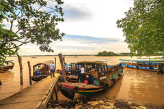 Moored Vietnamese tourist boats (julesnene) Tags: travel water river boats boat asia southeastasia vietnam waters moor mekongdelta mekong moored mekongriver localattraction wideangleshot boatsmoored canoneos7d julesnene juliasumangil mekongdeltarivercruise vietnamesetouristboats