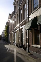 Oude Molstraat (Curtis Gregory Perry) Tags: road street holland building brick netherlands dutch shop nederland denhaag thehague oude straat molstraat tbakkertje