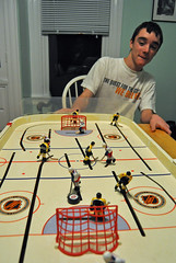 December 12: Playing board hockey (Blake Gumprecht) Tags: playing hockey board teenager bruins rangers stiga