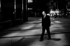 Business Man (Nate Sit) Tags: street bw white toronto black 35mm photography nikon shadows suit nate sit d90 18g