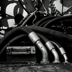 Pneumatik Enygmatik B&W (sandroraffini) Tags: industrial details steel urban abstract reality bw machinery pneumatic ratchets light shadows enygma street exploration cables lines curves tangle surfaces textures dirt