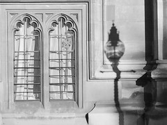 cast a crooked shadow (JudyGr) Tags: gwl guesswherelondon unguessed london img4880bw shadow window netcurtains lamp westminsterpalace housesofparliament gothic architecture urban fragment londonguessed guessedbyjim529