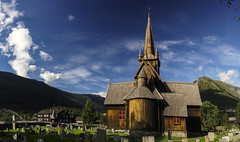 Lom stave church (wimvandemeerendonk, back home) Tags: church lom bright blue contrast color colors colours colour clouds cloud graveyard green dragon heaven architecture landscape light mountain monumental minolta norway outdoors outdoor panorama rock rocks sony sky sun valley wimvandem w viking vikingship
