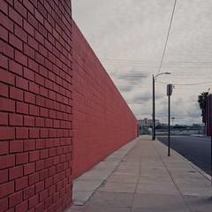 Dark red wall (ADMurr) Tags: la dtla brick red wall clouds gray wire rolleiflex planar zeiss kodak ektar film 6x6 mf square