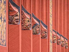 Ancient faces on the facade (typographics2010) Tags: faces face sculpture medieval basel cityhall switzerland head zany distortedhistory ancient relief wall red narrative facade town