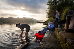Vietnamese women washing clothing and grass mats by the side of river in Tom Coc, Ninh Binh. (Joseph.chia2820) Tags: vietnam women river people travelphotography photography outdoor