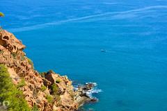 Une barque bleue sur une mer bleue (Ath Salem) Tags: algrie algeria coast cte mditerrane mediterranean      boucheghal bouchghal boucheral          doumia tenes chlef oued goussine beni haoua plages littoral magnifique somptueux corniche dahra dechria decheria sidi abderrahmane     sea algerian beach amazing