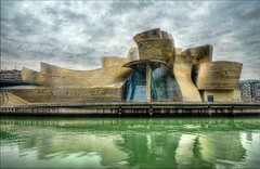 The Guggenheim Museum Bilbao Reprocessed (Hans Kool) Tags: color colour art beautiful wall museum architecture gold golden interestingness nice nikon shiny nobody nopeople bilbao awsome gelb stunning mostinteresting glimmen guggenheim dor hdr goud spiegeling glimmend d90 1685mm