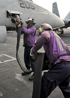 From http://www.flickr.com/photos/56594044@N06/8161048720/: Sailors refuel an aircraft aboard USS Nimitz.