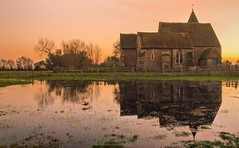 St.Clements...... ( EXPLORED ) (Jez22) Tags: old light sunset copyright reflection church water field saint st architecture century religious kent glow dusk marsh fading 12th clements romney jeremysage