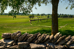 Grass is Greener (Majtek862) Tags: morning trees light summer sky color green nature grass leaves metal stone wall rural vintage landscape rocks shadows view gardening earth antique farm sunny hose machinery sprinkler bark shade kansas lichen sod irrigation