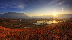Les vignes de Saint Andr (Girolamo's HDR photos) Tags: morning blue autumn light shadow red sky sun sunlight lake france mountains tree art nature water clouds sunrise canon reflections french landscape photography gold vineyard fisheye savoie 8mm hdr rayoflight apremont rhnealpes girolamo photomatix samyang tonemapping canoneos50d lacsaintandr cracchiolo mygearandmegold mygearandmeplatinum mygearandmediamond omalorig wwwomalorigcom