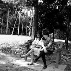 Eleanor & Amanda (The91) Tags: portrait bw amanda 6x6 film mediumformat square chair singapore fuji kodak seagull leg 11 d76 negative squareformat sunglass mf neopan 100 eleanor glade rayban wy acros 75mm  seagull4a103 4a103 4a103